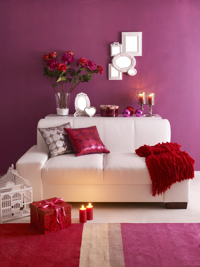 Shades of purple and red bring warm jewel tones to a room. Let the eye rest with a neutral color like white.